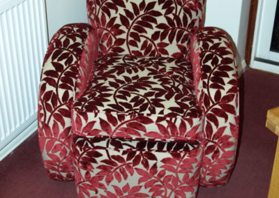 This style of chair is known as a Bugatti style. The name coming from the shape of a type 35 Bugatti rear wing.